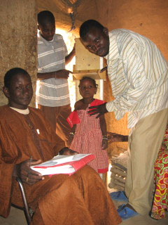 Enumerators measure children's heights