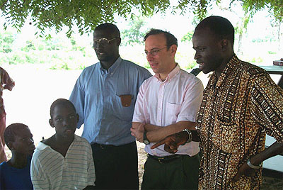 Photo of David Sahn and Leopold Sarr working on field test of education and health survey in Senegal